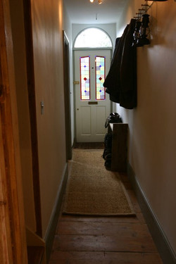 Front door & stained glass windows.