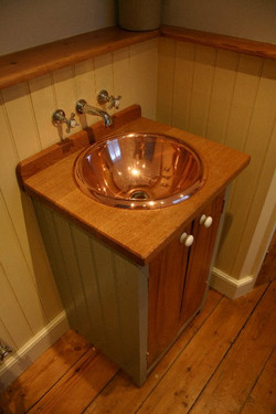 Copper basin freestanding cupboard.