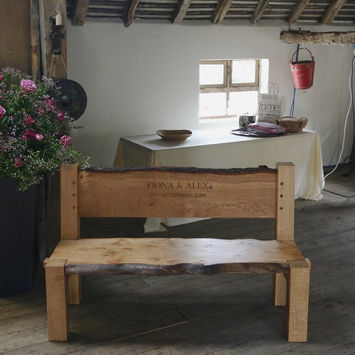 Solid oak bench with personalised hand carved message.