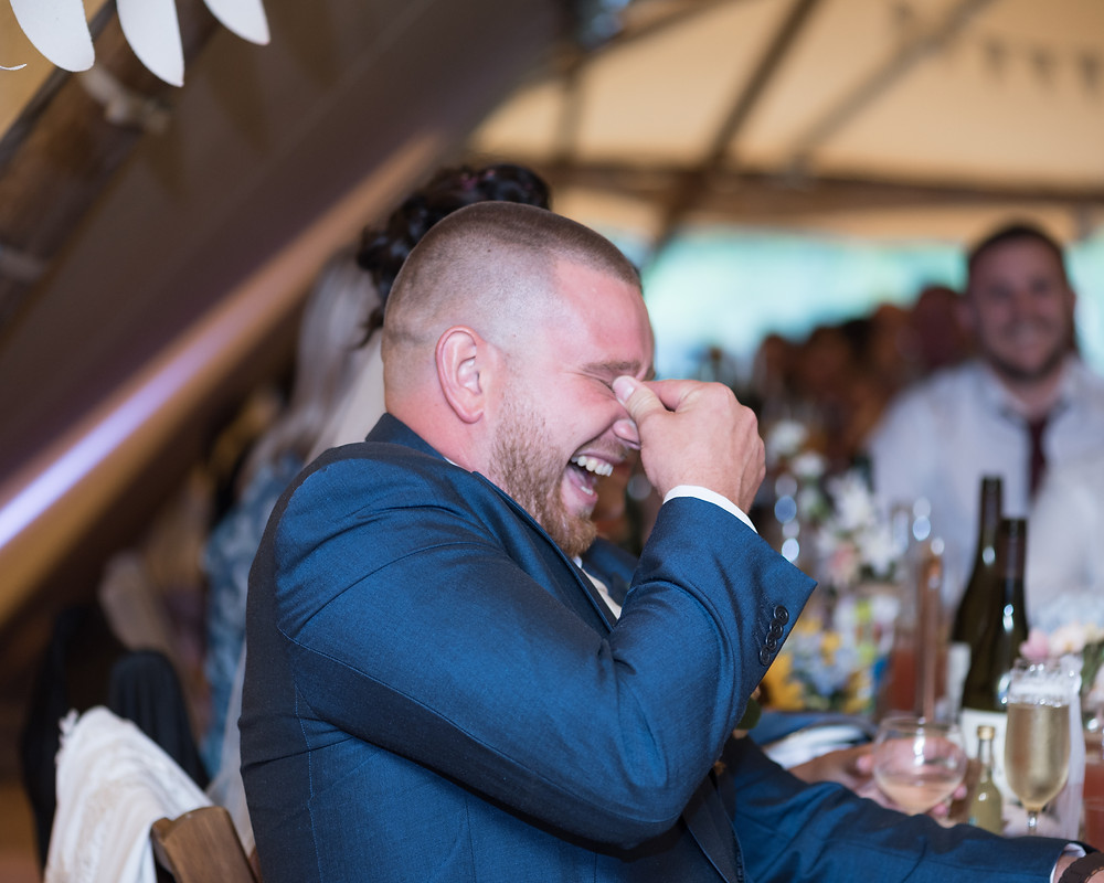 A groom listening to the Brides Speech. I love this pictures, it makes me smile
