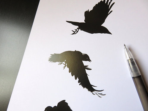 small print of three flying crows in black and white