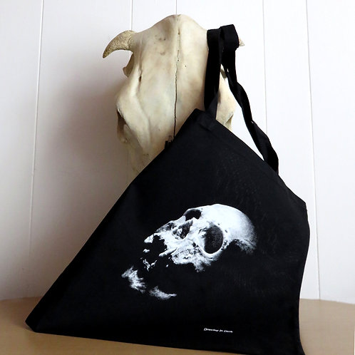 Human skull tote shopping bag with gothic skull art on black background with shoulder straps