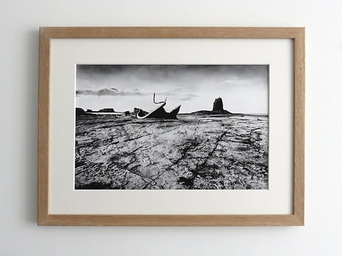 small wood framed art print of the admiral van tromp wreck at Saltwick Bay near Whitby North Yorkshire