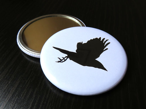 flying rook small round mirror with black and white back