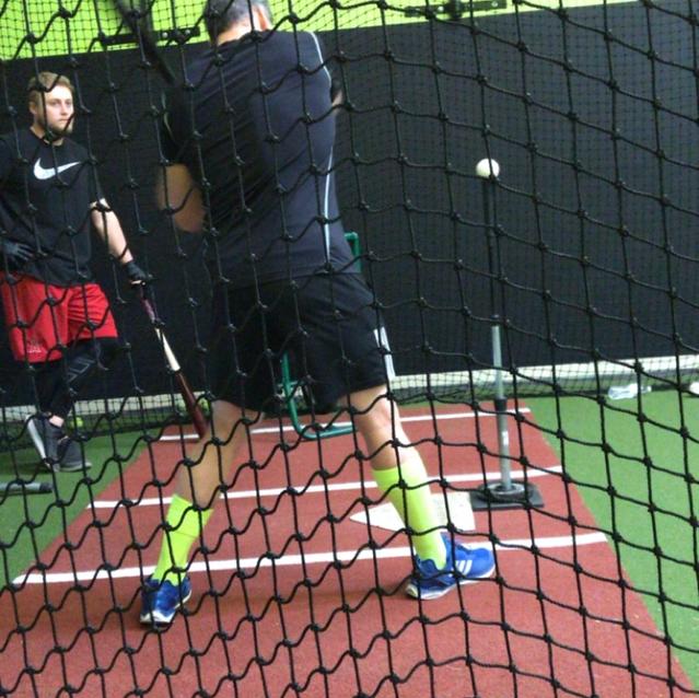 Scott Instructing Others On Hitting