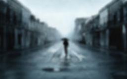 sad-man-with-umbrella-walking-in-a-lonel