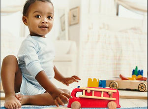 Boy playing with educational wooden toys for 2 year olds