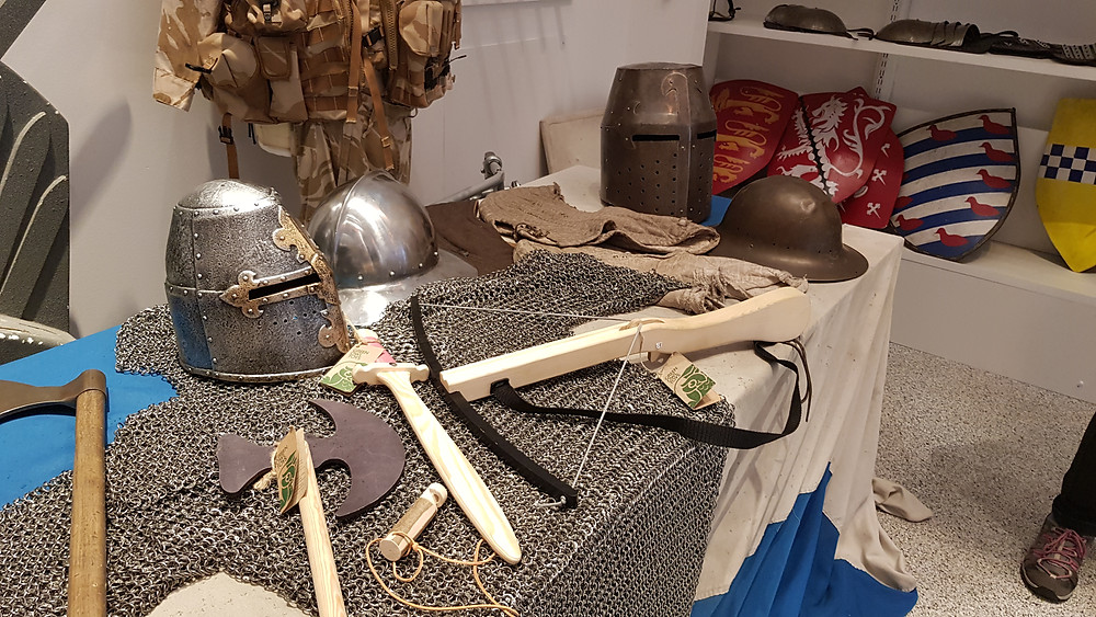 Plastic helmet and cool wooden weapons on display