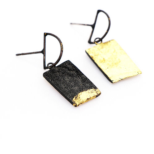 Skin. Double sided earrings with gold leaf