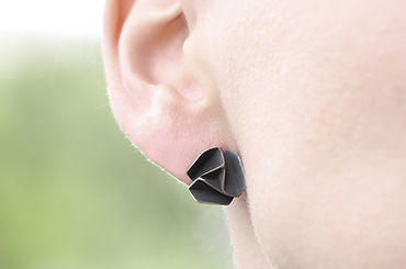 pinwheels that are similar to schematic flowers. Silver earrings