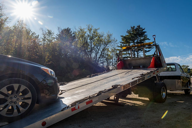 Car being loaded on tow truck