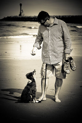 John Guariano Of The Yard Gard on Cape Cod with on of his three dogs