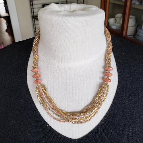 Gold and soft pink multi-strand necklace with beaded rope