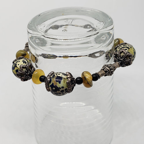 Black and Yellow Lampwork Beads with Black Onyx Bracelet