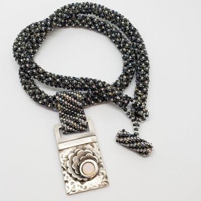 Pure silver pendant with nano opal.jpg