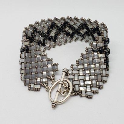silver and hematite wide bracelet
