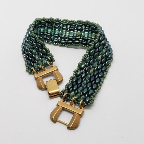 green and brass bracelet
