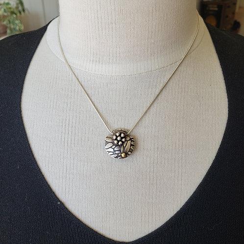 2 Sided Silver Pendant. Flower and Gold Dot. Flowing Flower. Lentil Pendant.