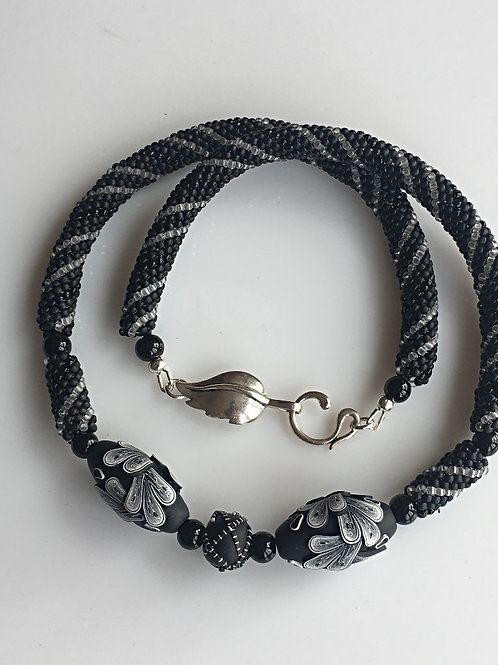 Black and White Beaded Rope with Polymer Leaf Focals