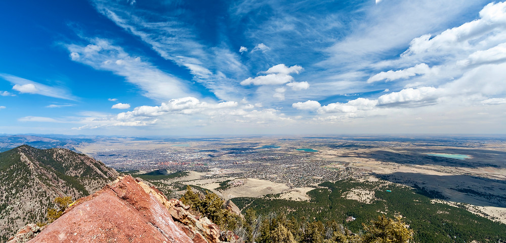 view of downtown Boulder Colorado from the top of the Bear Peak