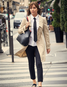On her way to murder an elite perfumier at a Paris gala, Villanelle has to blend in with the event's servers — but still dresses up the required uniform. She adds her own stylish touch with a secondhand Prada Mac trench coat and Zara trousers.