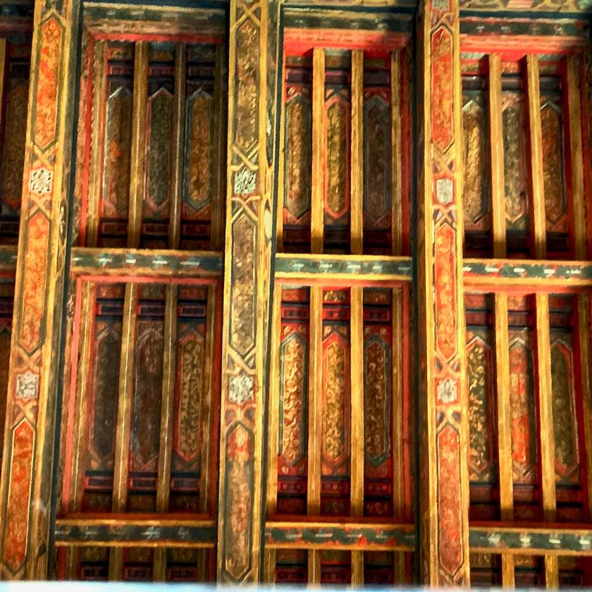 a painted wood ceiling in the Casa de Pilatos