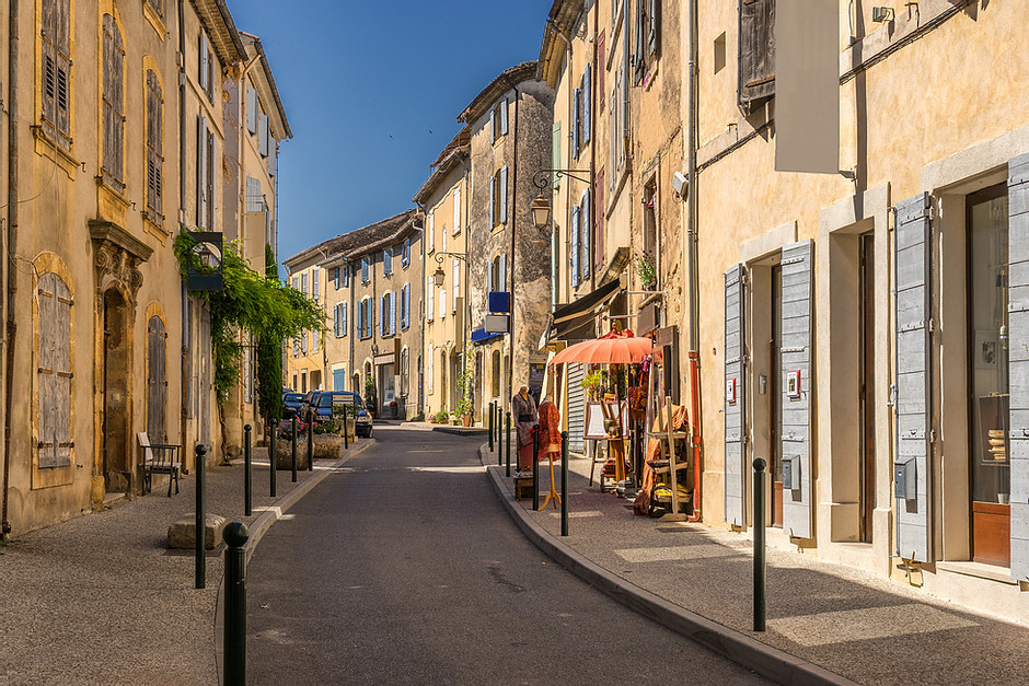 street in the hilltop village of Lourmarin with French blue shutters