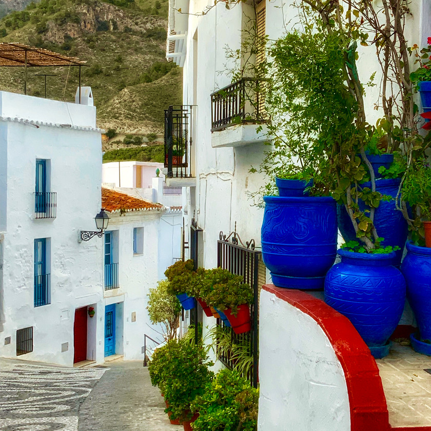 a pretty street with blue pottery in Frigiliana Spain