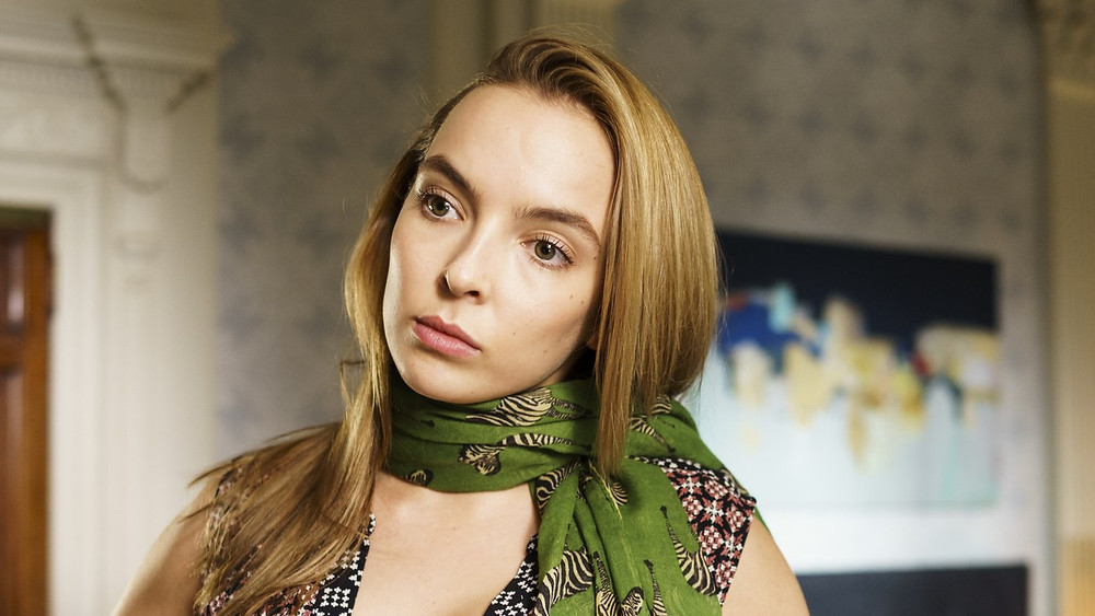 Villanelle sneaks into Eve's apartment and steals her scarf.