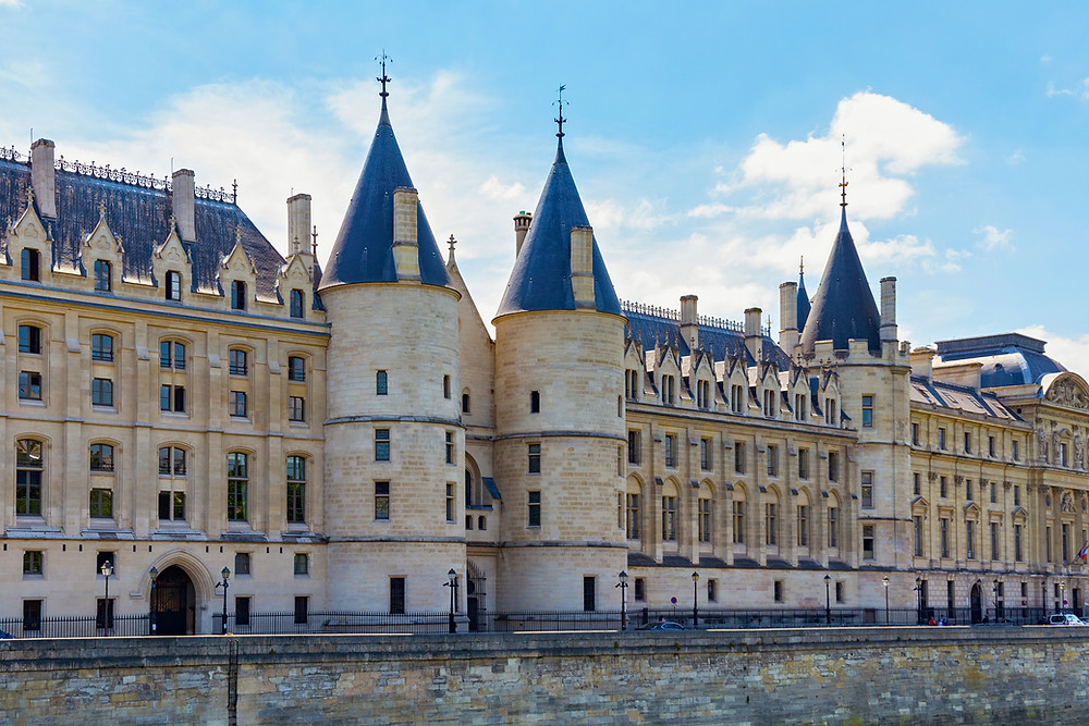 Gothic exterior of the Conciergerie on the River Seine