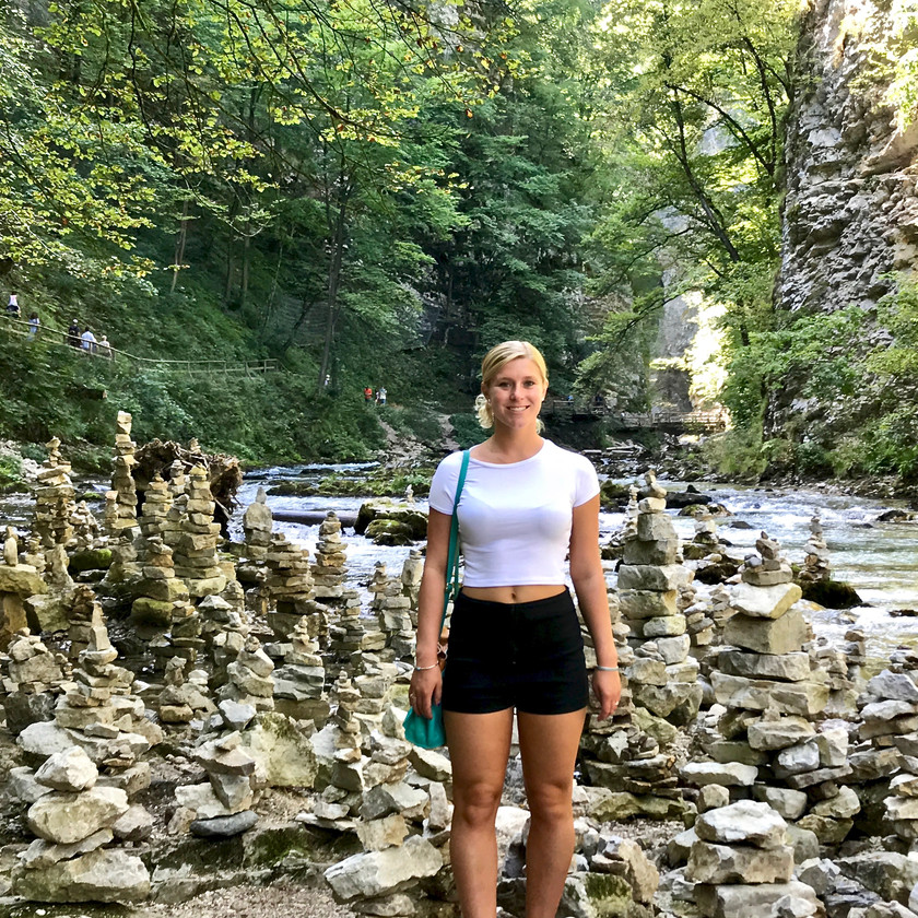 my daughter standing in rock formation at Vintgar Gorge