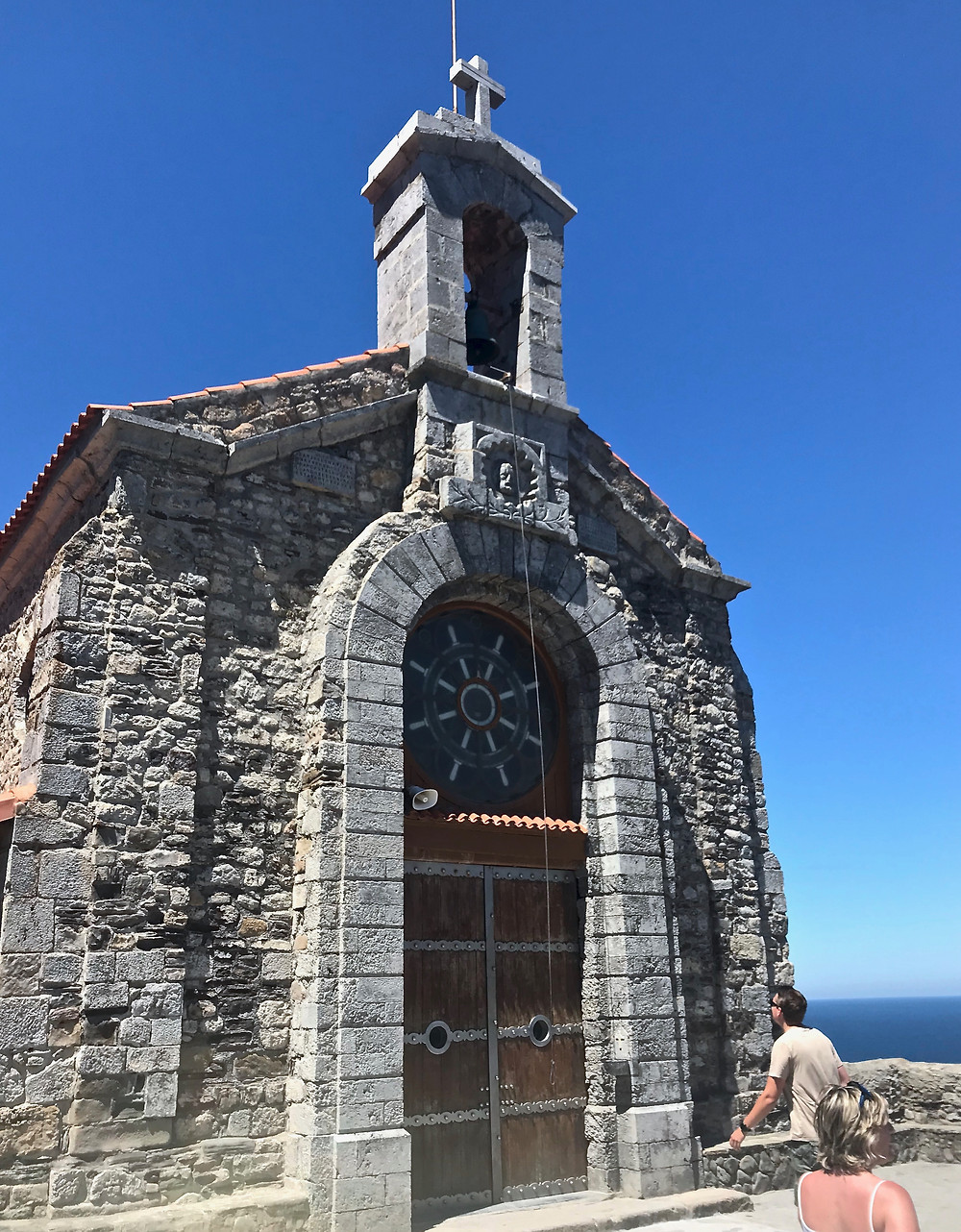 the hermitage church of San Juan de Gaztelugatxe where tourists ring the bell hoping to make wishes and banish demons