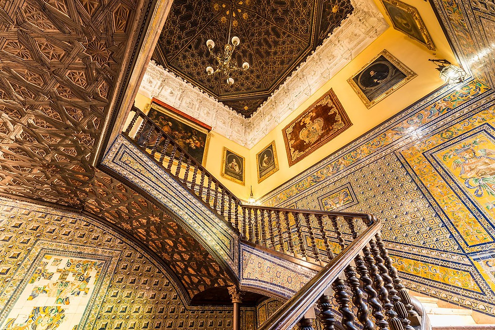 the dramatic tiled staircase between the first and second floor in the Palacio de Lebrija