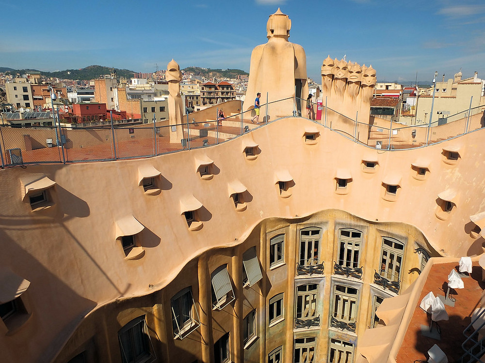 the surreal rooftop of La Pedrera with the whispering windows