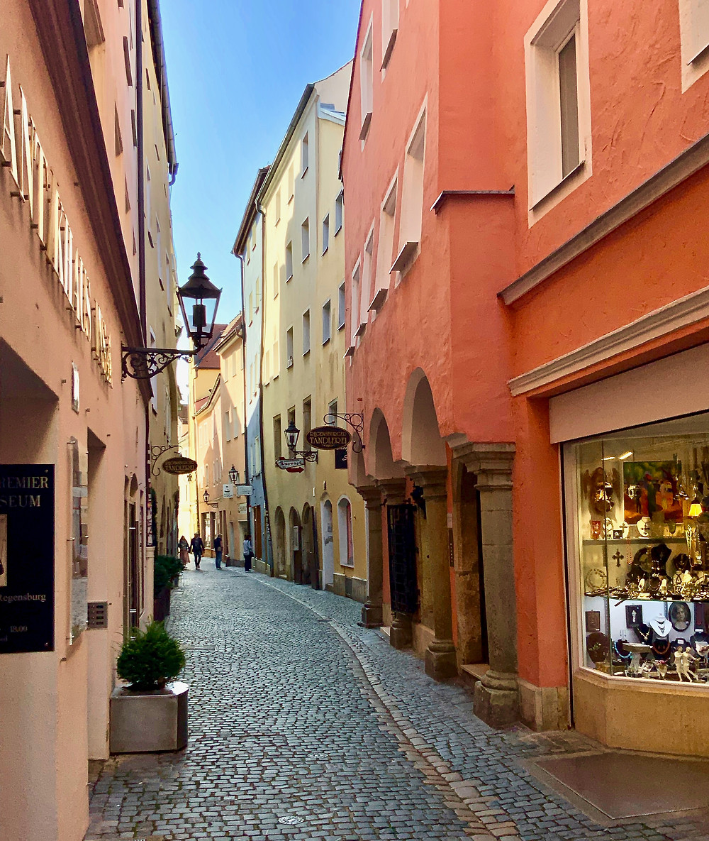 pretty pastel houses on a medieval street in Regensburg