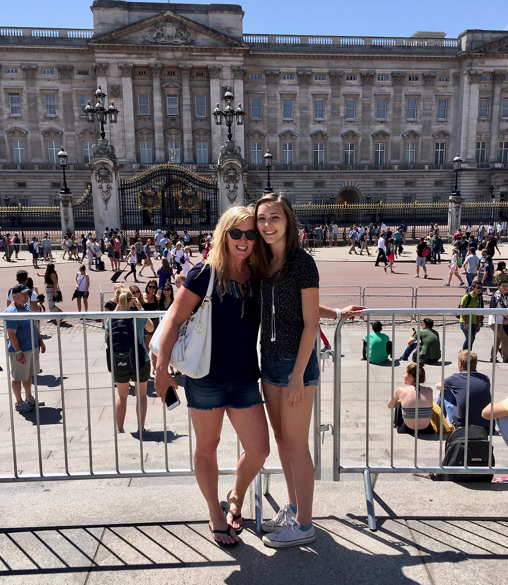 my daughter and I getting our snap at Buckingham Palace