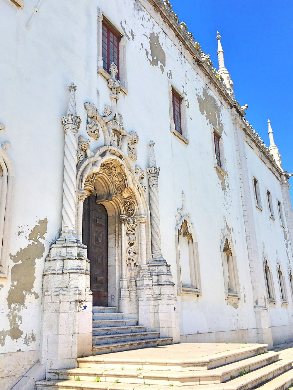 facade of Lisbon's National Tile Museum with a Manueline door