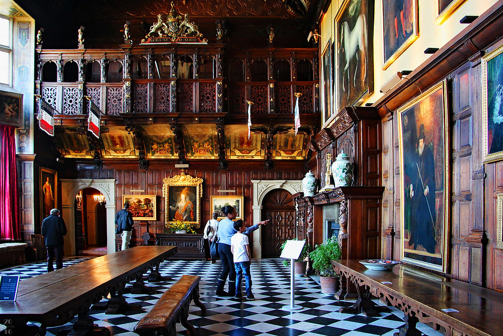 the Marble Hall of Hatfield House with the famous Rainbow Portrait of Elizabeth