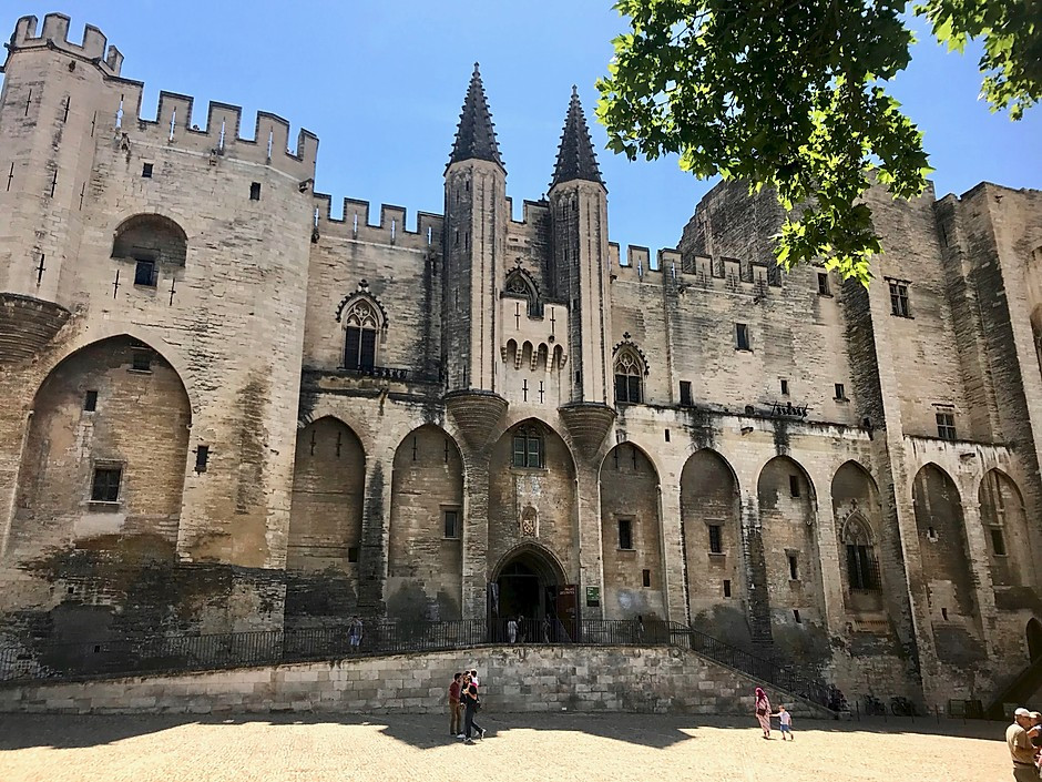 the imposing Gothic facade of the pope's Palace in Avignon