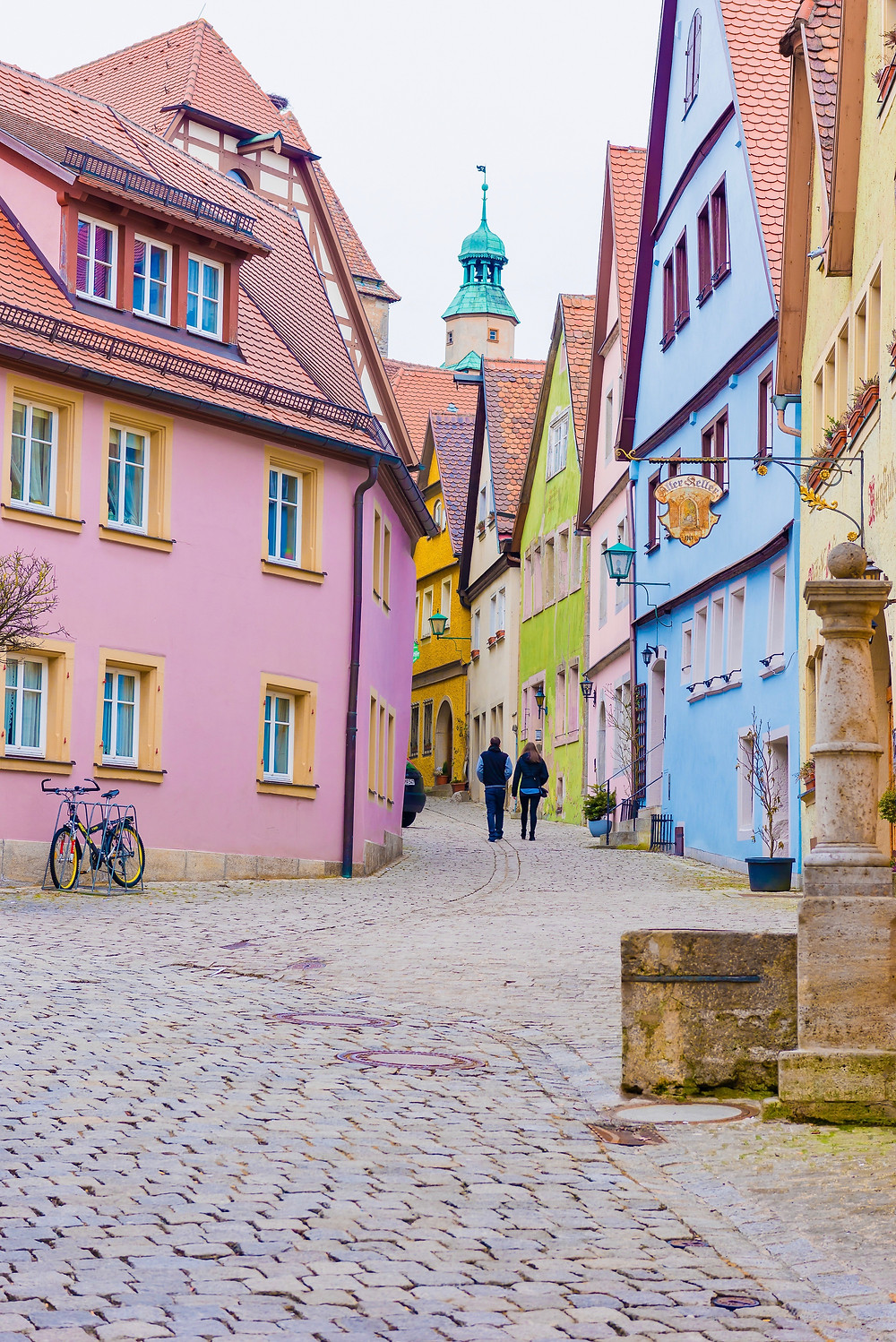 pretty cobbled street and pastel houses in Rothenburg ob der Tauber in Bavaria Germany