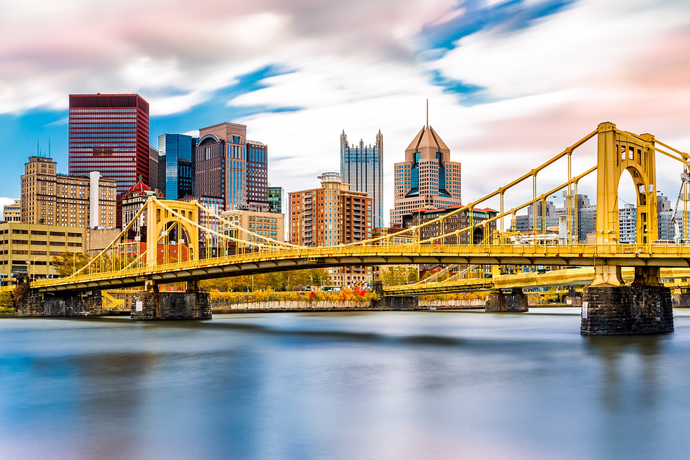 the Clemente Bridge with the Pittsburgh skyline