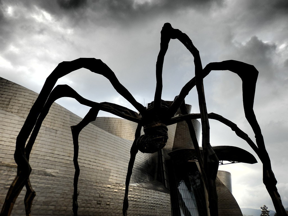 an eerie photo of Louise Bourgeois' Maman, 1999
