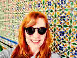 me, enjoying the beautiful tiles in the Casa de PIlatos in Seville