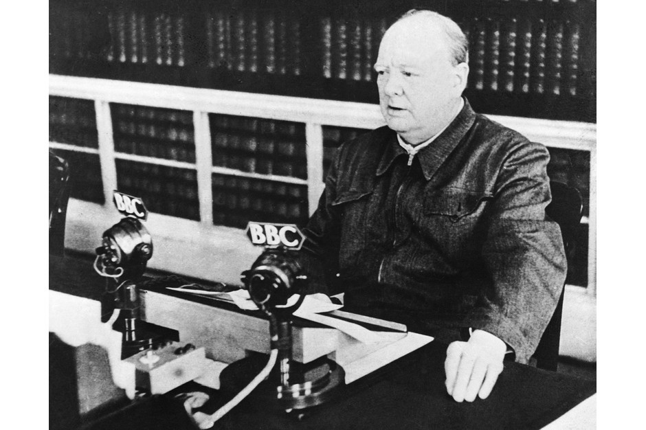 """""""I have nothing to offer but blood, toil, tears and sweat"""": Winston Churchill delivers a speech on the BBC in May 1940. (Keystone-France via Getty Images)"""