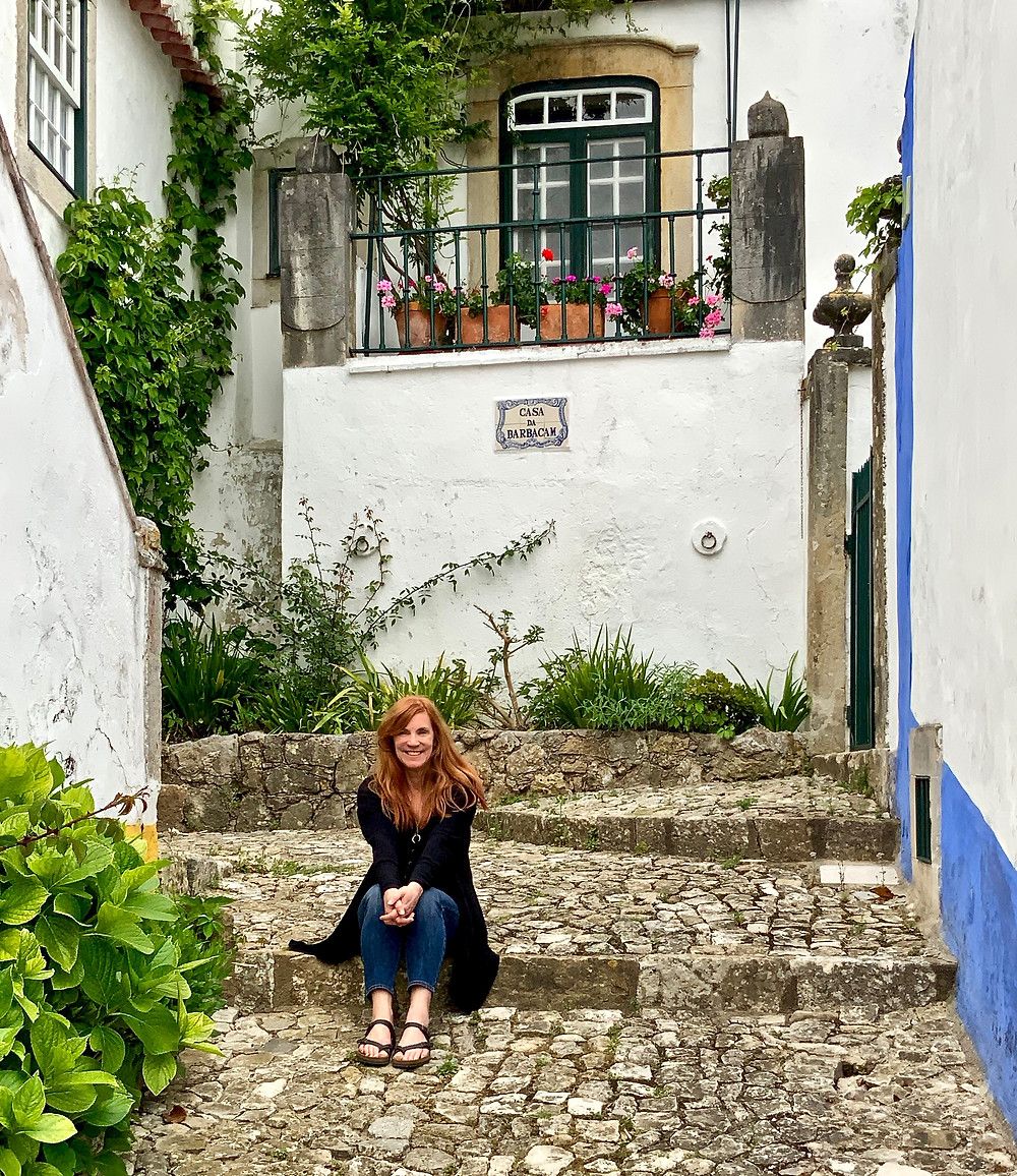 hanging out on a cobbled pedestrian street in Obidos