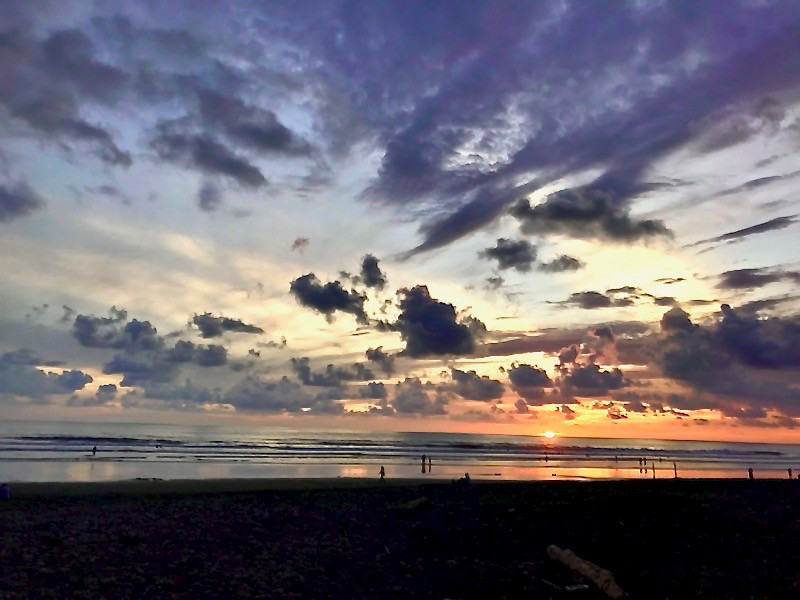 experiencing a beautiful sunset on Dominicalita Beach in Costa Rica