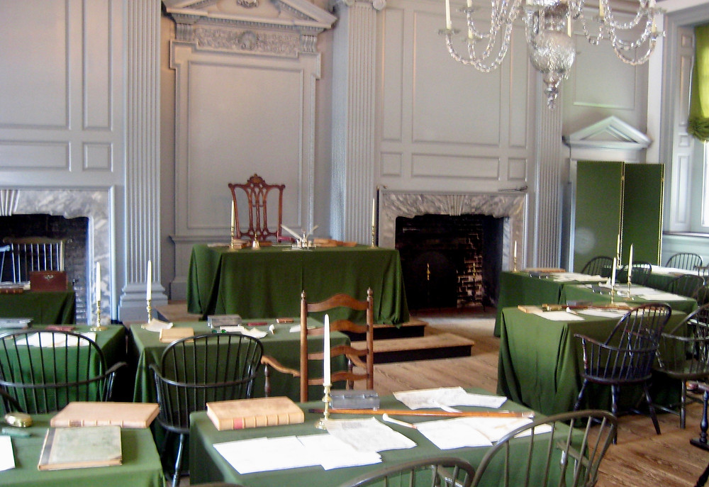 """the Assembly Room, with George Washington's """"rising sun"""" chair in the center"""