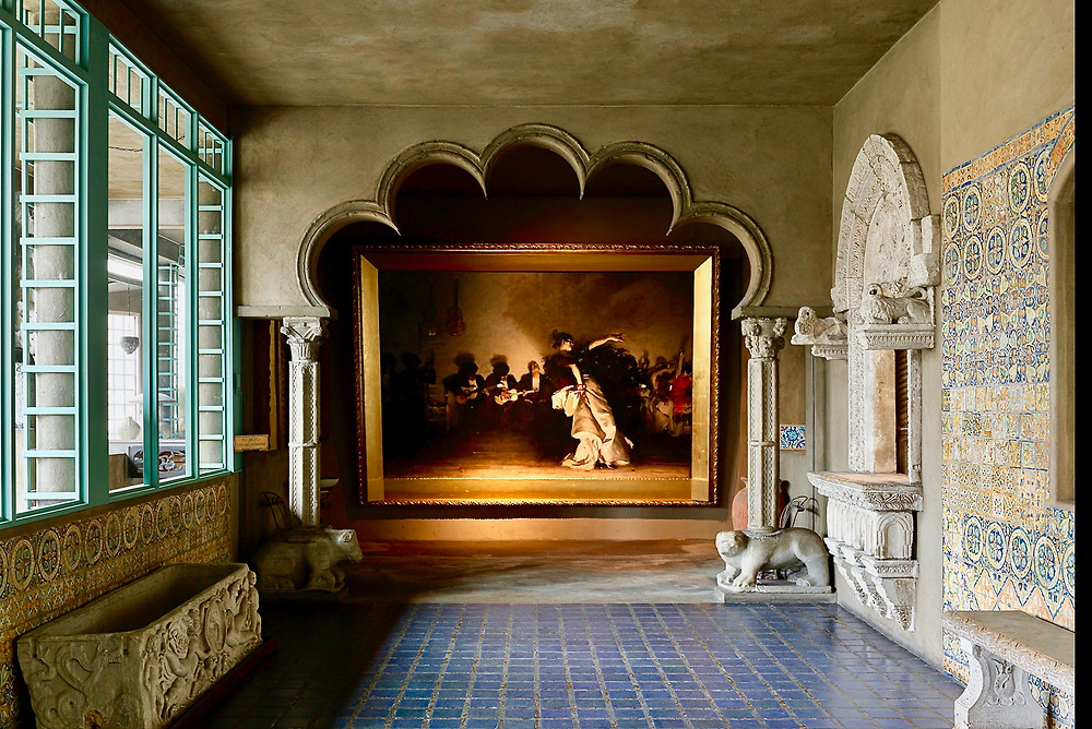 John Singer Sargent's El Jaleo in the Spanish Cloister, framed by Moorish arches