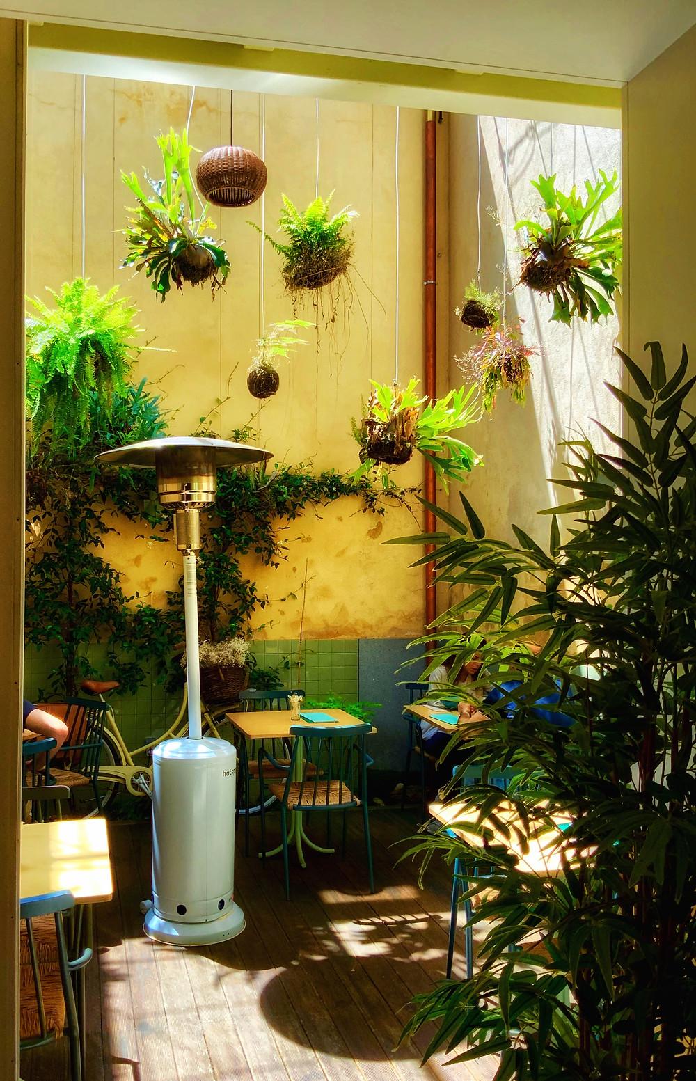 the cute enclosed terrace garden of Noshi Coffee