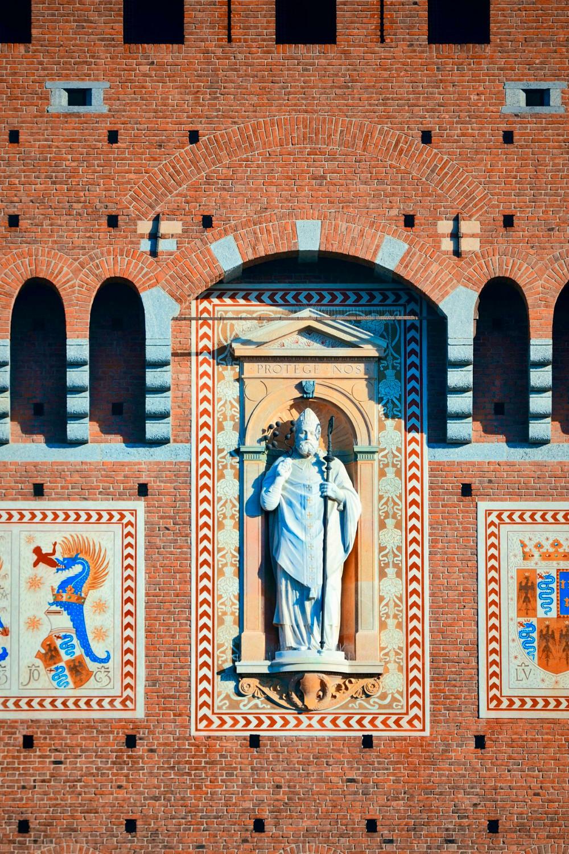 sculpture of St. Ambrose on the facade of Castle Sforza